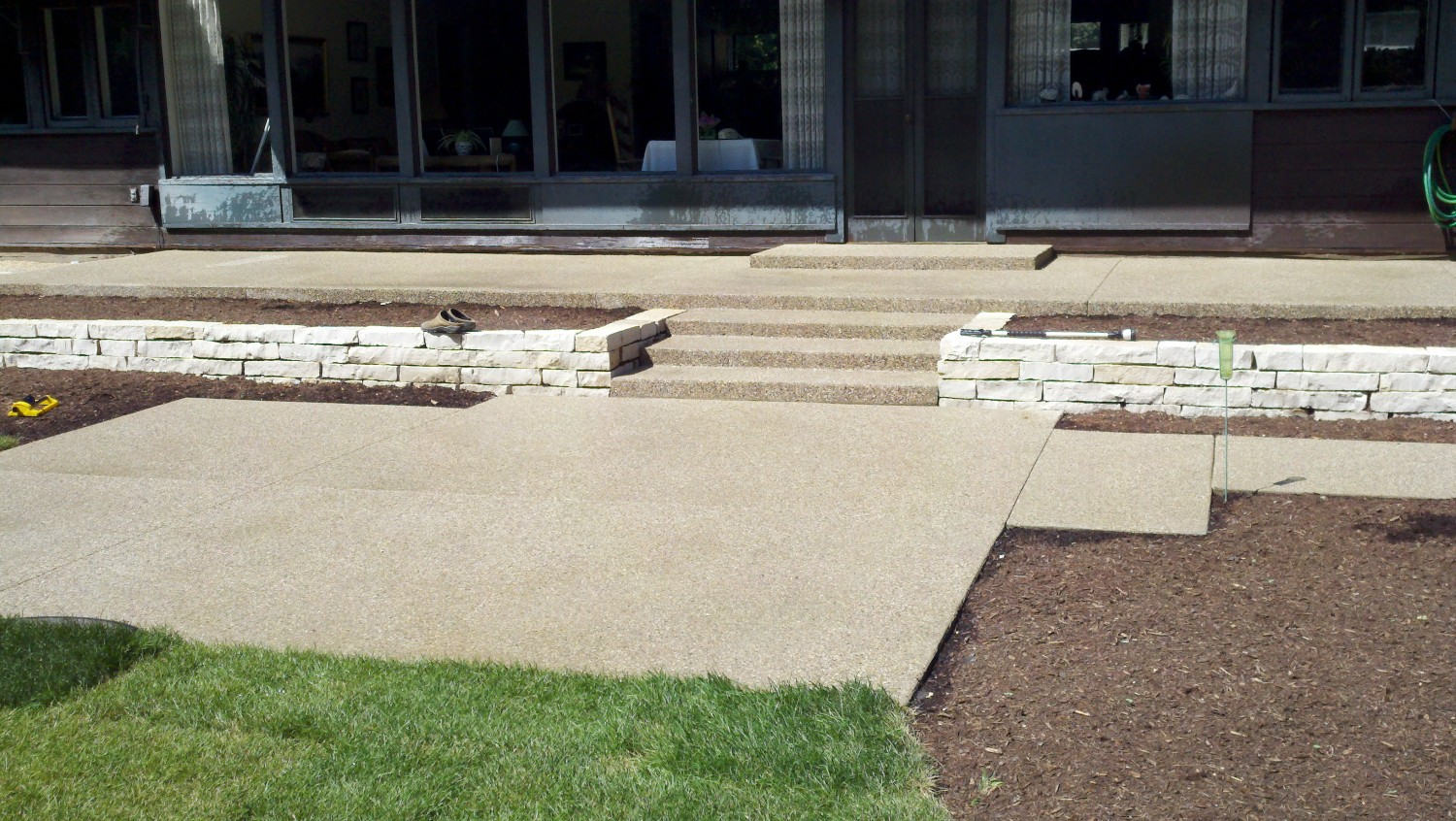 Multi Level Exposed Aggregate Patio And Stairs
